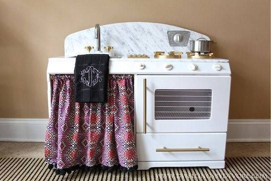 30-pretend-kitchens-we-kind-of-wish-were-real-kid-kitchens-white-and-granite-kid-kitchen-with-monogram-towel-5788507781c866970ee812b9-w1000_h1000