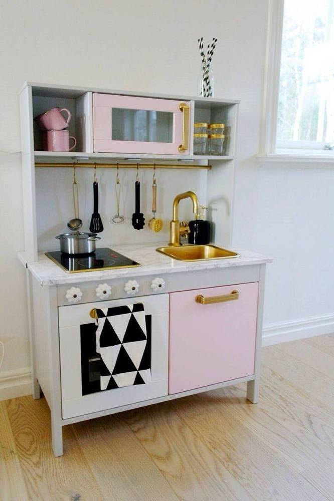 30-pretend-kitchens-we-kind-of-wish-were-real-kid-kitchens-white-kid-kitchen-with-pink-door-578850d281c866970ee812c3-w1000_h1000